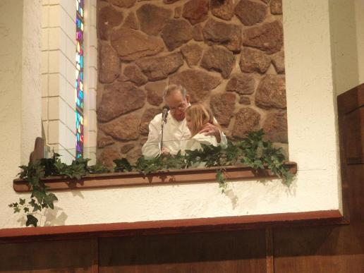 Ted Bartell baptizes his granddaughter, Emily